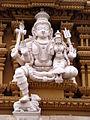 Shiva and Parvati sculptures in stucco on gopura of Srikanteshvara temple at Nanjanagudu.jpg