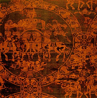 A portion of the 814 death shroud of Charlemagne. It represents a quadriga and was manufactured in Constantinople. Musee de Cluny, Paris. Shroud of Charlemagne manufactured in Constantinople 814.jpg