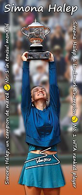 Halep holding the trophy above her head and smiling with her eyes closed