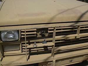 Commercial Utility Cargo Vehicle - Close-up of the NATO slave receptacle on an M1009