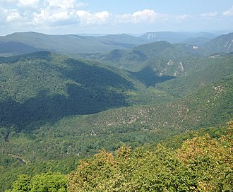 Smoke Hole Canyon - View of Smoke Hole Canyon from atop Cave Mountain. Visible are the South Branch Potomac River and the Big Bend (bottom), as well as Castle Rock and North Fork Gap (distance).