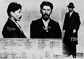 three pictures of the same man with a mustache and dark hair: one profile picture, one mug shot picture, and one picture of the man standing with a hat dressed in a black overcoat, white shirt, black pants and black shoes