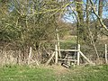 Stile and footbridge on the High Weald Landscape Trail - geograph.org.uk - 1742539.jpg