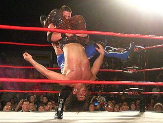 Facebuster - Styles preparing to perform the Styles Clash on Matt Hardy.