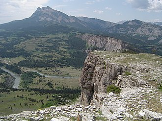 Thrust fault - An example of thin-skinned deformation (thrusting) in Montana.  Note that the white Madison Limestone is repeated, with one example in the foreground and another at a higher level to the upper right corner and top of the picture.