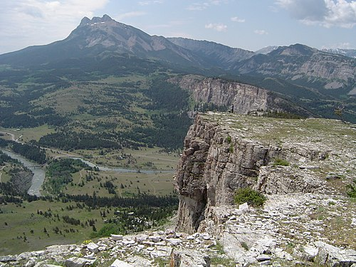 An example of thin-skinned deformation (thrust faulting) of the Sevier Orogeny in Montana. Note the white Madison Limestone repeated, with one example in the foreground (that pinches out with distance) and another to the upper right corner and top of the picture. SunRiver.JPG