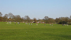 London Football Association - A Sunday football match in progress at Brook Farm open space.