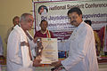 Surendra Nath Acharya being felicitated by Bhartruhari Mahtab (2).jpg