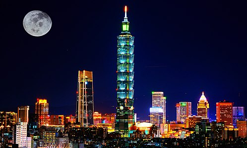 Taipei skyline cityscape at night with full moon.jpg
