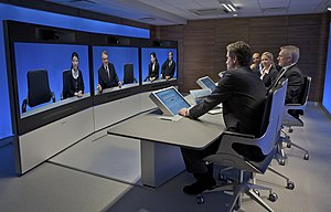 History of videotelephony - A Tandberg T3 high definition telepresence room in use some 40 years after the introduction of AT&T's black and white Picturephone (2008).