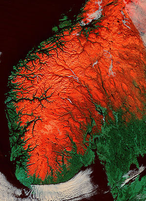 Paleic surface - Satellite image of southern Norway, higher areas shown in as red. If studied carefully zones of gentle slopes and flat terrain can be discerned in the uplands. These make up the paleic surface.