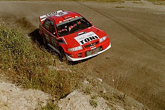 Toni Gardemeister - Gardemeister driving a Lancer Evo at the 2001 Rally Finland.