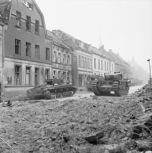 Operation Veritable - A Valentine Mk XI Royal Artillery OP tank (left) and a Churchill tank (right) in Goch, 21 February 1945