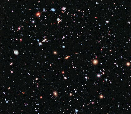 The Hubble eXtreme Deep Field (XDF) was completed in September 2012 and shows the farthest galaxies ever photographed. Except for the few stars in the foreground (which are bright and easily recognizable because only they have diffraction spikes), every speck of light in the photo is an individual galaxy, some of them as old as 13.2 billion years; the observable universe is estimated to contain more than 2 trillion galaxies. The Hubble eXtreme Deep Field.jpg