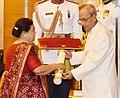 The President, Shri Pranab Mukherjee presenting the Padma Vibhushan Award to Smt. Kokilaben Ambani, wife of Shri Dhirubhai Hirachand Ambani (Posthumous), at a Civil Investiture Ceremony, at Rashtrapati Bhavan, in New Delhi.jpg