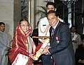 The President, Smt. Pratibha Devisingh Patil presenting the Padma Bhushan Award to Shri Dharmendra Deol, at an Investiture Ceremony-II, at Rashtrapati Bhavan, in New Delhi on April 04, 2012.jpg