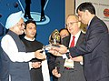 The Prime Minister Dr. Manmohan Singh presented the Lifetime Achievement Award Petrotech-2010, at the inauguration of 9th International Oil and Gas Conference and Exhibition (Petrotech) 2010, in New Delhi.jpg