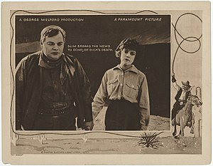 """The Round-Up (1920 film) - Lobby card: """"Slim breaks the news to Echo of Dick's death."""""""