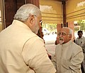 The Vice President, Shri Mohd. Hamid Ansari being welcomed by the Prime Minister, Shri Narendra Modi on his arrival at Parliament House to attend the Joint Session of the Parliament, in New Delhi on June 09, 2014.jpg