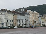The promenade, Llandudno. The large number of hotels, shops, wide promenade and the Great Orme make this a very popular holiday resort in North Wales