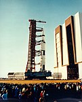 The second Apollo 16 roll-out attracts a crowd at the Vehicle Assembly Building.jpg