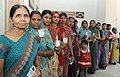 The women voters standing in a queue to cast their votes, at a polling booth, during the 9th Phase of General Elections-2014, in Varanasi, Uttar Pradesh on May 12, 2014.jpg
