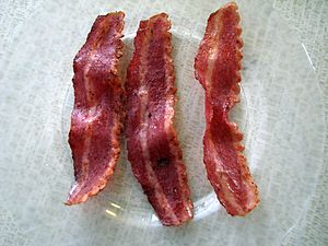 Three strips of cooked turkey bacon