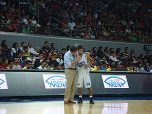 Magnolia Hotshots - San Mig Coffee coach Tim Cone talks to Mark Barroca during their semifinal game against Barangay Ginebra