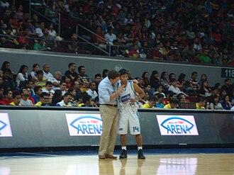 Magnolia Hotshots - San Mig Coffee coach Tim Cone talks to Mark Barroca during their semifinal game against Barangay Ginebra