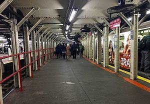 Times Square–42nd Street/Port Authority Bus Terminal (New York City Subway) - Shuttle platform for track 3. A shuttle train can be seen on the same track.