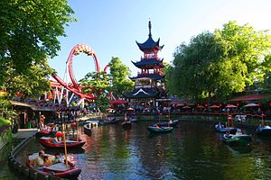 Tivoli Gardens - Dragon Boat lake and Dæmonen roller coaster in the background