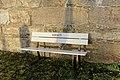 "Tjøme kirke Church White bench (parkbenk) marked ""The Church"" (""Kirken"") by stone wall Winter afternoon light light No snow Færder Municipality, Norway 2020-01-15 1864.jpg"