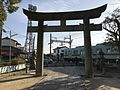 Torii of Enoki Shrine and train of Nishitetsu Tenjin-Omuta Line 2.jpg