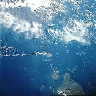 Torres Strait - The Torres Strait seen from space – Cape York Peninsula is at the bottom; several of the Torres Strait Islands can be seen strung out towards Papua New Guinea to the north.