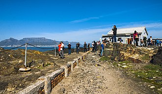 Tourism in South Africa - Tourists taking in the view of Cape Town and Table Mountain from Robben Island