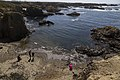 Tourists on glass beach.jpg