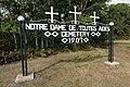 Toutes Aides Roman Catholic Church - cemetery sign.jpg