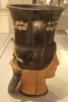 Trinkgefaess in Form einer Menaden- und einer Silenenmaske 1.JPG
