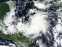 Satellite image of a tropical cyclone with banding features but no eye.