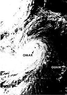 Black and white satellite image of Typhoon Omar depicting the storm's well-defined eye and expansive cyclonic cloud cover.