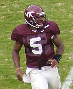 An American college football player wearing a maroon No. 5 uniform and helmet.