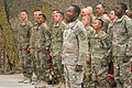 U.S. Army Pfc. Kemar Wedderburn, center, an indirect fire infantryman with the 2nd Squadron, 2nd Cavalry Regiment, leads a group of newly naturalized Soldiers in the Pledge of Allegiance during a naturalization 131111-Z-MH103-114.jpg