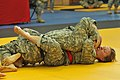 U.S. Army Sgt. Erin Van Maanen, red belt, with 12th Combat Aviation Brigade, fights with Sgt. Bob Hall, with US Army Europe, at the combatives lane during Europe's 120802-A-BS310-110.jpg
