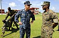 U.S. Navy Capt. Michael Jacobsen with members of the Barbados Defense Force practicing self-defense techniques.jpg