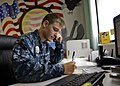 U.S. Navy Master-at-Arms Apprentice Erik Wright takes notes while on a phone call during his one day stand-in position as command master chief of Naval Support Facility Diego Garcia, British Indian Ocean 131029-N-S2424-011.jpg