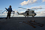 U.S. Sailors remove chock and chains from a French Army SA 380 Puma helicopter as it takes off from the amphibious dock landing ship USS Pearl Harbor (LSD 52) while underway in the Pacific Ocean June 28, 2013 130628-N-WD757-227.jpg