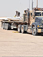 U.S. Soldiers secure parts of a downed aircraft wreckage onto a vehicle during a training exercise on Contingency Operating Base Adder, Iraq, July 5, 2011 110705-A-FE031-001.jpg