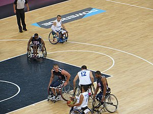 United States at the 2012 Summer Paralympics - The US men's wheelchair basketball team in action against Italy in the group stage of the tournament.