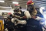 USS Bonhomme Richard (LHD 6) Air Department Sailors Combat Simulated Fire 170224-N-XT039-395.jpg