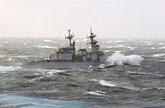 US Navy 021029-N-0120R-004 The destroyer USS Paul F. Foster turns away after an attempt to replenish fuel